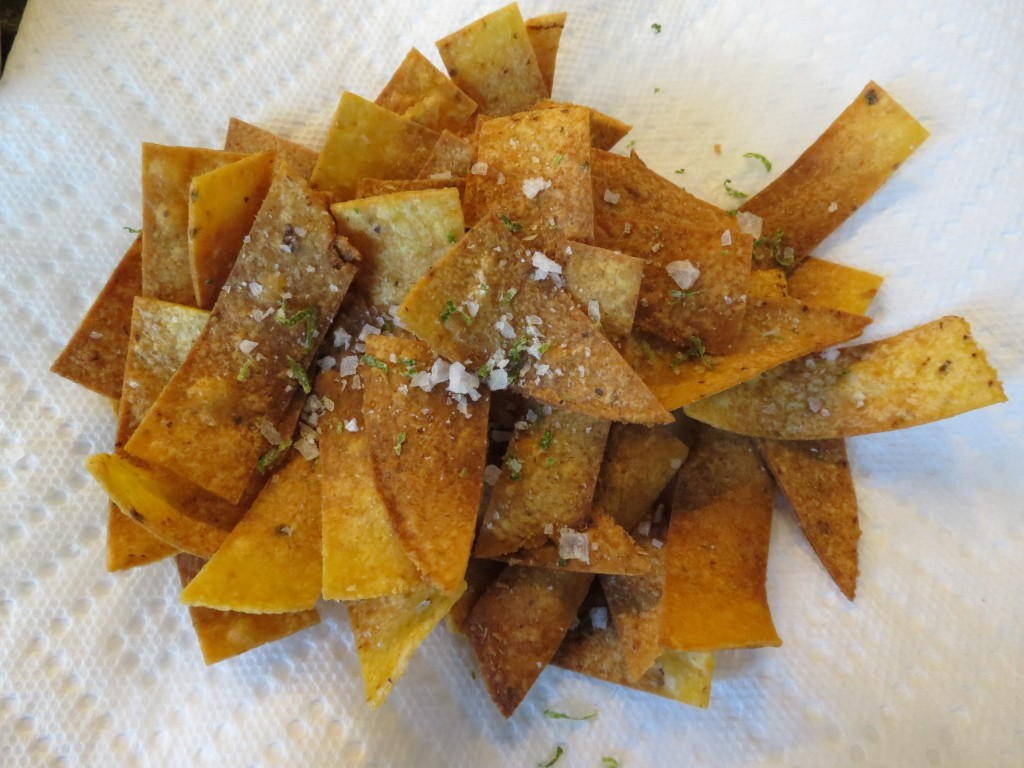 Pan fried fresh corn tortillas, topped with fresh lime salt.  Addictive.  Crunchy.  Salty.  Presses all the right buttons.