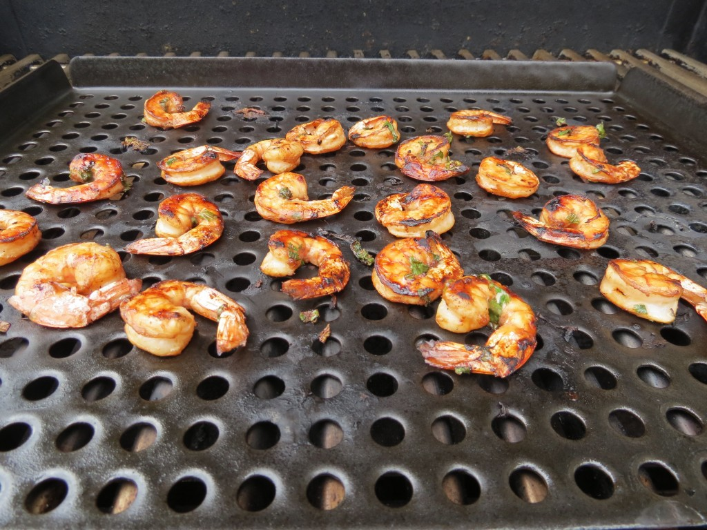 I used a grilling basket to cook the shrimp on the grill.  It made it easier for me to get them off the grill and into a bowl, but you could just as easily grill them directly on your barbecue.  Just make sure you've oiled the surface first to prevent sticking.