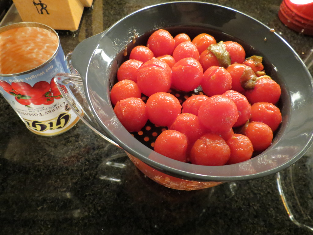 Draining the cherry tomatoes for my Meatzza topping.  I subbed these for the chopped tomatoes and it was a success!